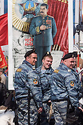 Moscow, Russia, 09/05/2006..OMON riot police in front of a banner of Stalin as Russians celebrated the 61st anniversary of the end of the Second World War, generally referred to in Russia as the Great Patriotic War.
