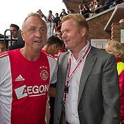 Amsterdam, 03-07-2013. Oud-Ajaxied Sjaak Swart wordt 75 jaar en krijgt een jubileumwedstrijd in het Olympisch Stadion te Amsterdam. Vele oud-Ajax gedienden waren uitgenodigd. Mr. Ajax - Sjaak Swart maakte deel uit van oud-Ajax elftal. Foto: Johna Cruijff en Ronald Koeman.
