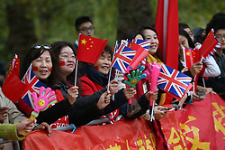 © Licensed to London News Pictures. 20/10/2015. London, UK. People gather in The Mall ahead of Chinese President Xi Jinping's four day State Visit to the United Kingdom. Photo credit: Peter Macdiarmid/LNP