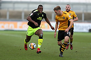 Uche Ikpeazu of Cambridge Utd  (l) goes past Mickey Demetriou of Newport county (r). The Emirates FA Cup, 2nd round match, Newport County v Cambridge United at Rodney Parade in Newport, South Wales on Sunday 3rd December 2017.<br /> pic by Andrew Orchard,  Andrew Orchard sports photography.
