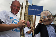 """Politcal action group Avaaz wear Rupert Murdoch masks outside Parliament during News International phone hacking scandals. As the News International Chairman and his son sit  inside the committee rooms answering difficult questions about the phone hacking scandals, the activists protest outside. Avaaz—meaning """"voice"""" in several European, Middle Eastern and Asian languages—launched in 2007 with a simple democratic mission: organize citizens of all nations to close the gap between the world we have and the world most people everywhere want."""