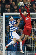 Watford goalkeeper Heurelho Gomes (1) denies Queens Park Rangers forward Matt Smith (17) again in the air  during The FA Cup 5th round match between Queens Park Rangers and Watford at the Loftus Road Stadium, London, England on 15 February 2019.