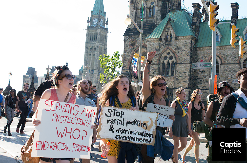 People shout during a march against police brutality in Ottawa. August 23, 2014.