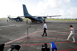 France's President Emmanuel Macron arrives on the tarmac of Pointe-a-Pitre airport, Guadeloupe island, followed by French Overseas Minister Annick Girardin, to meet the media upon his arrival in the Guadeloupe island, the first step of his visit to French Caribbean islands, Tuesday, Sept. 12, 2017. Photo by Christophe Ena/Pool/ABACAPRESS.COM