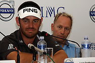 DURBAN - 8 January 2014 - South African golfer Louis Oosthuizen answers questions from the press as European Tour tournament director Mikael Eriksson looks on. Oosthuizen is the defending champion, having won the Volvo Golf Chasmpions event in Durban in 2013. Picture: Allied Picture Press/APP