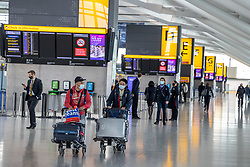 """© Licensed to London News Pictures. 09/04/2021. London, UK. Passengers walk through Heathrow Terminal 5. Today, Transport Secretary Grant Shapps sets out details of the government's """"traffic Light"""" system for May 17th so that the public can travel abroad with passengers requiring to take a private covid-19 test each way, costing as much as £150.00 for one test. Photo credit: Alex Lentati/LNP"""
