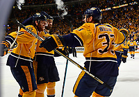 NASHVILLE, TN - MAY 09:  Colin Wilson #33 of the Nashville Predators is congratulated by teammates James Neal #18 and Barret Jackman #5 after scoring the game tying goal during the third period of Game Six of the Western Conference Second Round against the San Jose Sharks during the 2016 NHL Stanley Cup Playoffs at Bridgestone Arena on May 9, 2016 in Nashville, Tennessee.  (Photo by Frederick Breedon/Getty Images)