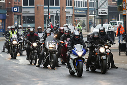 © Licensed to London News Pictures. 06/12/2016. Wakefield, UK. A large group of motor bikers escort the funeral procession of Andrew Broadhead and his daughter Kiera on it's way to Wakefield Cathedral in West Yorkshire. Andrew Broadhead, 42, died whilst trying to save his 8-year-old daughter Kiera from a house fire. Photo credit : Ian Hinchliffe/LNP