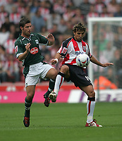 Photo: Lee Earle.<br /> Southampton v Plymouth Argyle. Coca Cola Championship. 16/09/2006. Southampton's Inigo Idiakez (R) battles with David Norris.