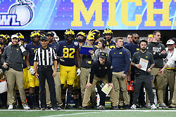 Michigan Wolverines head coach Jim Harbaugh looks on from the sidelines Jim Harbaugh during the Chick-fil-A Peach Bowl, Saturday, December 29, 2018, in Atlanta. (Jason Parkhurst via Abell Images for Chick-fil-A Peach Bowl)