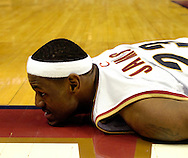 PHOTO BY DAVID RICHARD.LeBron James nearly ended up face-first on the floor after a hard foul during a Cavaliers' loss to Detroit last night.