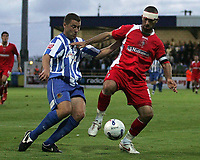 Photo: Paul Thomas.<br /> Chester City v Swindon Town. Coca Cola League 2. 01/09/2006.<br /> <br /> Christian Roberts (R) of Swindon wins the ball from Sean Hessey.