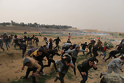 March 30, 2019 - Al-Buraj Refugee Camp, The Gaza Strip, Palestine - Thousands of Palestinians gathered east of Al-Buraj refugee camp in the middle of the Gaza strip, a mass demonstration to mark the one-year anniversary of the 'Great march of Return', 3 Palestinian were killed 300 people injured after Israeli troops use live fire to break up the protest. (Credit Image: © Mahmoud Khattab/Quds Net News via ZUMA Wire)