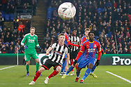 Grimsby Town midfielder Harry Clifton (15) and Crystal Palace forward Wilfried Zaha (11) await the corner of Grimsby Town midfielder Martyn Woolford (16) during the The FA Cup 3rd round match between Crystal Palace and Grimsby Town FC at Selhurst Park, London, England on 5 January 2019.