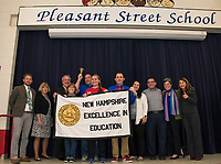 Principal Dave Levesque welcomes special guests during Friday mornings assembly announcing Pleasant Steet School as NH's Elementary School of the Year.  (l-r) Bryan Belanger, Gail Bourn, Larry Johnston, Linda Thanas, Jeff Greeley, Rebekah Gonzalez, Dave Levesque, Collette Hardy, Ron Pedro, Bridey Bellemare and Lois Costa.   (Karen Bobotas/for the Laconia Daily Sun)