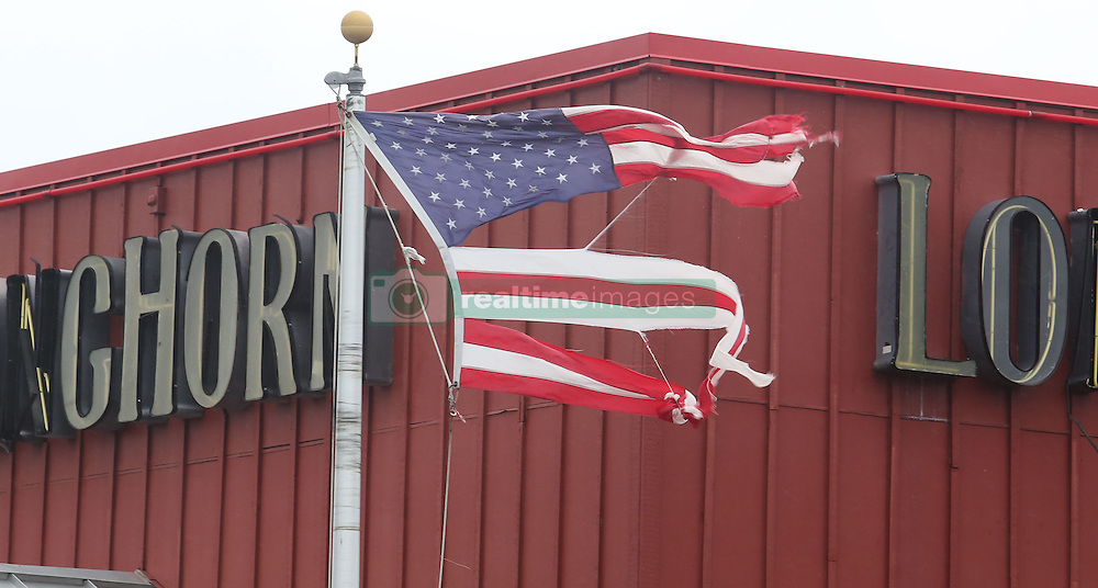 October 7, 2016 - Tallahassee, Florida, U.S. - Hurricane force winds ripped an American flag at Longhorn restaurant on Merritt Island.  Hurricane Matthew a  Category 4 storm brushed the Florida east coast. (Credit Image: © Red Huber/TNS via ZUMA Wire)