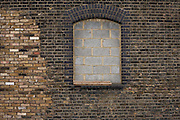 Breeze blocks have sealed up this window at Marshgate industrial estate, location for the 2012 Olympic village, Stratford, London England.