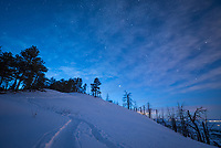 The deep blue colors of twilight glow above an unnamed mountain above Red Grade Road. After snowshoeing up here for the sunset, I stayed until the stars came out and the moon rose.