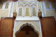 Arabesque Moorish plasterwork of the Dar Jamai Museum  a typical dwellings of high Moroccan bourgeoisie at the end of XIX century. located in the old Medina built by Mohamed Ben Larbi Jamai grend vizier of Sultan Moulay Hassan (1873-1894). Meknes, Morocco .<br /> <br /> Visit our MOROCCO HISTORIC PLAXES PHOTO COLLECTIONS for more   photos  to download or buy as prints https://funkystock.photoshelter.com/gallery-collection/Morocco-Pictures-Photos-and-Images/C0000ds6t1_cvhPo<br /> .<br /> <br /> Visit our ISLAMIC HISTORICAL PLACES PHOTO COLLECTIONS for more photos to download or buy as wall art prints https://funkystock.photoshelter.com/gallery-collection/Islam-Islamic-Historic-Places-Architecture-Pictures-Images-of/C0000n7SGOHt9XWI