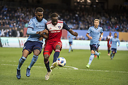April 29, 2018 - Bronx, New York, United States - New York City defender SEBASTIEN IBEAGHA (33) fights for the ball against FC Dallas forward ROLAND LAMAH (20) during a regular season match at Yankee Stadium in Bronx, NY.  NYCFC defeats FC Dallas 3 to 1. (Credit Image: © Mark Smith via ZUMA Wire)