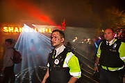 Glastonbury Festival, 2015. Shangri La is a festival of contemporary performing arts held each year within Glastonbury Festival. The theme for the 2015 Shangri La was Protest. <br />  Police in face paint arriving into the Hell area of the Shangri La field
