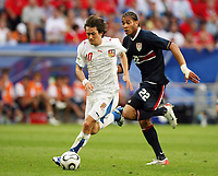 Photo: Chris Ratcliffe.<br /> USA v Czech Republic. Group E, FIFA World Cup 2006. 12/06/2006.<br /> Tomas Rosicky of Czech Republic goes through past Oguchi Onyewu of the USA to score the third Czech Republic goal.