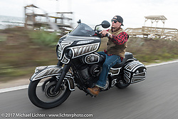 Jake Cutler of Barnstorm Cycle in Massachusetts riding his custom 2017 Indian Chieftain along the Atlantic Ocean during Daytona Beach Bike Week. FL. USA. Monday March 13, 2017. Photography ©2017 Michael Lichter.