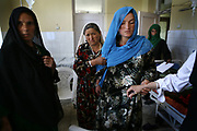 A pregnant woman enters the delivery room at Faizabad Provincial Hospital in Badakshan province, Afghanistan, Thursday, May 10, 2007. Faizabad Hospital's maternity unit has the most advanced facility in Badakshan. However, it also suffers from lack of facilities and staff especially female doctors. Afghanistan has the second highest maternal mortality rate in the world only after Sierra Leone. An astonishing number of 25,000 women die from obstetric causes per year, or 1 woman dies every 27 minutes. A UN report released in 2000 indicates that the national MMR in Afghanistan was 1,900 per 100,000 live births, whereas it was 17 in the United States. Ragh district in Badakshan province showed the highest mortality risk ever recorded in human history, with 64% - more than half of women - of reproductive age died during 1999 and 2002. The causes of deaths were analyzed mainly in two parts: direct and indirect. Direct causes include haemorrhage, obstructed labour, cardiomyopathy, sepsis, obstetric embolism, and pregrancy-induced hypertension; and the indirect causes were tuberculosis, malaria, and obstetric tetanus. Geographical and economical factors also contribute to high mortality in a place like Badakshan where most people have limited access to transportation thus making it harder for women to reach proper health care centers.