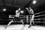 """Amateur Chessboxers Daniel Biman (left) and Mohamad Khadijah are engaged in a round of boxing during a chessboxing match at the Intellectual Fight Club in Berlin, Germany on the 15th of December 2017. <br /> Chessboxing is a literal combination of chess and boxing in a single match, demanding the players to quickly shift between mental and physical skills. The battle consists of 11 alternating rounds of chess and boxing, each lasting for 3 minutes. A game is won by checkmate, knockout or the judge's decision. <br /> The sport first got conceived of by the Slovak Bosnian comic book creator Enki Bilal, who introduced it in his futuristic graphic novel """"Cold Equator"""". Inspired by the book Dutch artist Iepe Rubingh staged the first fight in Amsterdam in 2003, which he himself fought and won. After that Iepe moved to Berlin and proceeded to found chessboxing-global.com, an organisation that strives to make the new sport popular worldwide."""