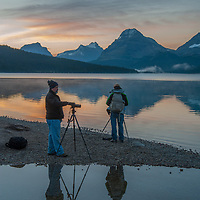 Photographers await the dawn beside Bow Lake in Banff National Park, Alberta, Canada. Behind (L to R) are Mount Andromache, Mount Hector and Bow Peak.