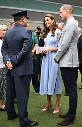 The Duke and Duchess of Cambridge meet Warrant Officer Dave Knights, who is due to retire from the AELTC after 15 years as a Service Steward, ahead of the Men's Singles Final on day thirteen of the Wimbledon Championships at the All England Lawn Tennis and Croquet Club, Wimbledon.