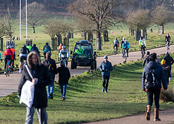 © Licensed to London News Pictures. 17/01/2021. London, UK. Police keep up patrols of the parks as members of the public enjoy a stroll in a very busy Richmond Park in South West London today. Earlier, the government pleaded with the public to stay at home as much as possible. And today, Foreign Minister Dominic Rabb said that lockdown could be lifted in March but with tier systems still in place as health chefs reveal that a 24/7 vaccination pilot will begin next week as total Covid-19 deaths reach over 88,000 this weekend. Photo credit: Alex Lentati/LNP