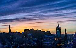 Edinburgh, Scotland, UK. 24 December 2020. Beautiful Christmas Eve and Brexit Deal sunset over Edinburgh viewed from Calton Hill tonight. Iain Masterton/Alamy Live News.
