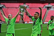 Forest Green Rovers celebrate promotion to the football league with the play off final trophy held by Forest Green Rovers Liam Noble(15) and Forest Green Rovers Keanu Marsh-Brown(7) during the Vanarama National League Play Off Final match between Tranmere Rovers and Forest Green Rovers at Wembley Stadium, London, England on 14 May 2017. Photo by Adam Rivers.