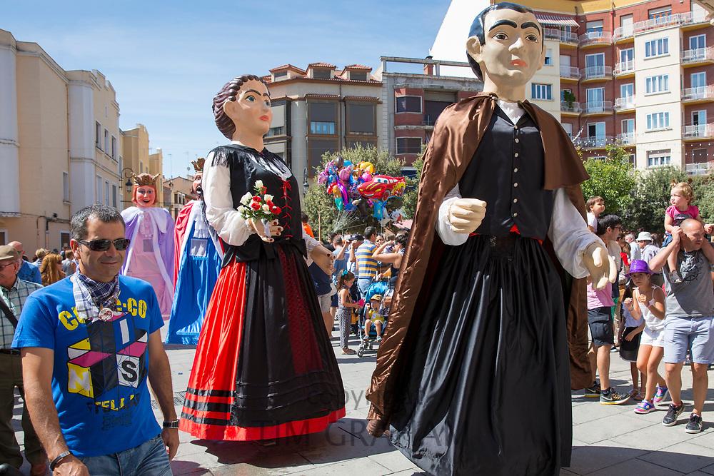 Children watch fiesta parade gigantes giant characters in Aranda de Duero, Castile and Leon, Spain