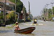 Woman in a boat, Bangkok, Thailand