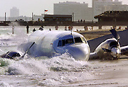 A cargo plane rests in the surf along North Miami Beach, in Florida, December, 7, 2001. The Miami-based Trans Air Inc. cargo plane crash landed after the pilot reported problems with the twin engine plane. Both the pilot and co-pilot walked away from the crash with minor injuries. The National Transportation Safety Board is invesitigating the cause of the mishap.  PHOTO BY:COLIN BRALEY