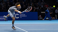 Tennis - 2019 Nitto ATP Finals at The O2 - Day One<br /> <br /> Singles Group Bjorn Borg: Roger Federer (Switzerland) vs. Dominic Thiem (Austria)<br /> <br /> Dominic Thiem (Austria) stretches to reach the passing shot <br /> <br /> COLORSPORT/DANIEL BEARHAM