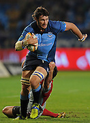 PRETORIA, South Africa, 07 May 2010. Danie Rossouw turns on the gas in his 100th Super Match for the Bulls with Zac Guildford of the Crusaders making the tackle during the Super 14 match between the Bulls and the Crusaders at Loftus Versfeldt in Pretoria, South Africa on 07 May 2010.<br /> Photographer : Anton de Villiers / SPORTZPICS