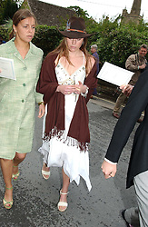 JESSICA CRAIG (with hat) at the wedding of Hugh van Cutsem to Rose Astor in Burford, Oxfordshire on 4th June 2005.<br />