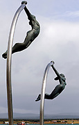 Statues of a man and a woman diving into Ultima Esperanza Sound. Puerto Natales, Chile 17Feb13