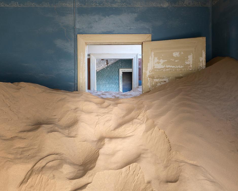 Kolmanskop is an abandoned town in the Namib desert.The desert has now reclaimed this once prosperous diamond mining settlement.
