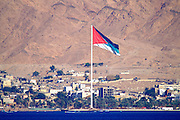 Jordanian flag on the border between Aqaba, Jordan and Eilat, Israel Eilat, pop. 55,000, is Israel's southernmost city in the Southern District of Israel. Adjacent to the Egyptian city of Taba and Jordanian port city of Aqaba, Eilat is located at the northern tip of the Gulf of Aqaba, which is the eastern sleeve of the Red Sea.