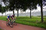 In Berkel en Rodenrijs rijden fietsers door het polderlandschap langs weilanden en bloemenkassen.<br /> <br /> In Berkel en Rodenrijs cyclists pass the pastures and greenhouses.