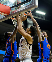 Texas A&M center Tyler Davis (34) puts back a rebound against Florida forward Kevarrius Hayes (13) and forward Keith Stone (25) of an NCAA college basketball game Tuesday, Jan. 2, 2018, in College Station, Texas. (AP Photo/Sam Craft)