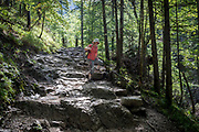 A hiker walks along the footpath near Sarnia Skala, a mountain in the Tatra National Park, on 16th September 2019, near Koscielisko, Zakopane, Malopolska, Poland.