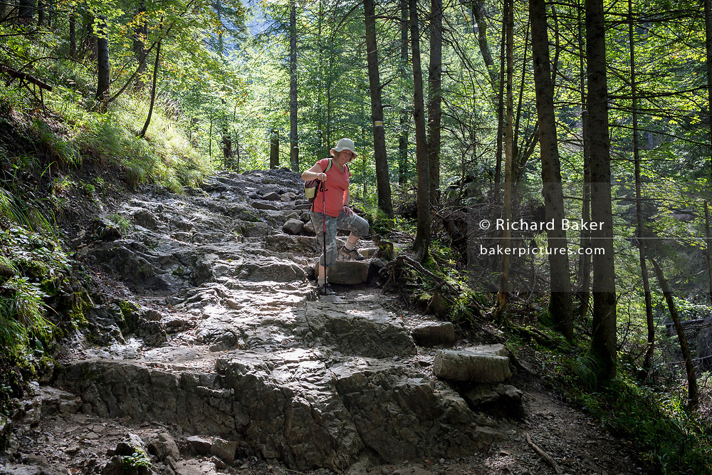 A hiker walks along the footpath near Sarnia Skala, a mountain in the Tatra National Park, on 16th September 2019, near Koscielisko, Zakopane, Malopolska, Poland.