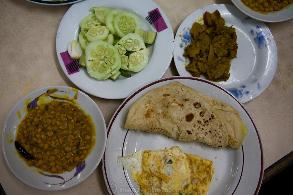 Breakfast of dal, mixed vegetables, paratha and egg at a café near the central train station in Dhaka, Bangladesh
