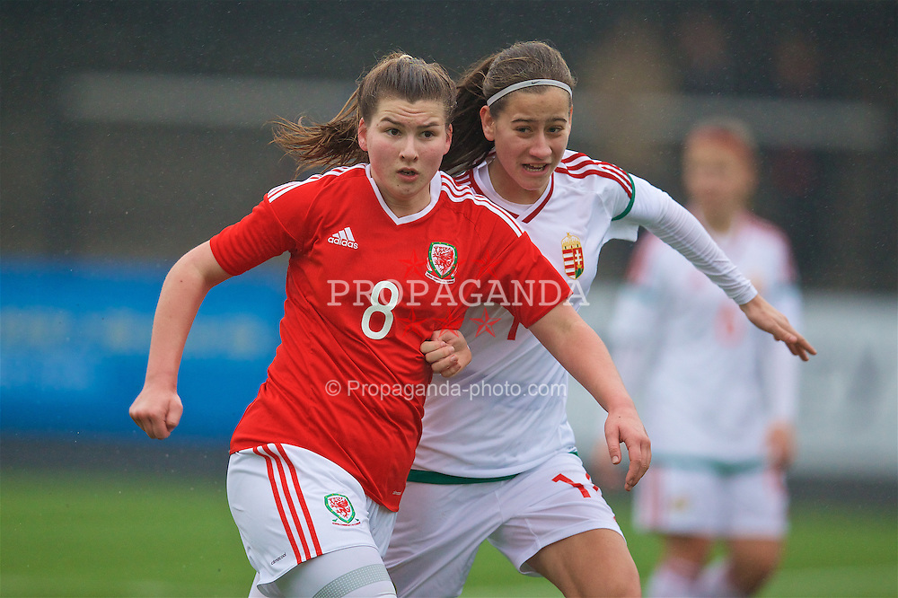 MERTHYR, WALES - Tuesday, February 14, 2017: Wales' Alice Griffiths in action against Hungary's Kovács Eszter during a Women's Under-17's International Friendly match at Penydarren Park. (Pic by Laura Malkin/Propaganda)