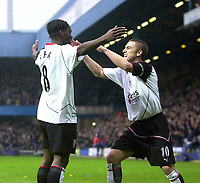 Photo. Glyn Thomas.<br /> Fulham v Southampton. FA Barclaycard Premiership. <br /> Loftus Road, London. 26/12/2003.<br /> Louis Saha is congratulated by captain Lee Clark (R) after scoring his side's first half goal.